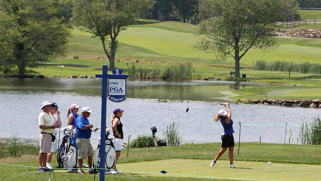 Golfers hit off on the 9th tee during a practice round for the KPMG Women's PGA Championship at Westchester Country Club in Harrison June 10, 2015.
