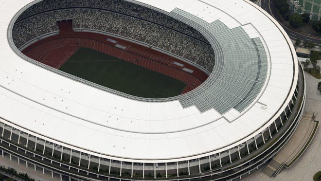 This aerial photo shows the New National Stadium, main stadium for the Tokyo Olympics and Paralympics, in Tokyo, on July 21. The postponed Tokyo Olympics have again reached the one-year-to-go mark. But the celebration is small this time with more questions than answers about how the Olympics can happen in the middle of a pandemic. That was before COVID-19 postponed the Olympics and pushed back the opening to July 23, 2021.