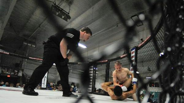 Cage fighting comes to the TD Convention Center this weekend.