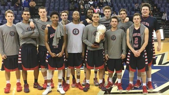 The Carolina Day boys basketball team won the Wells