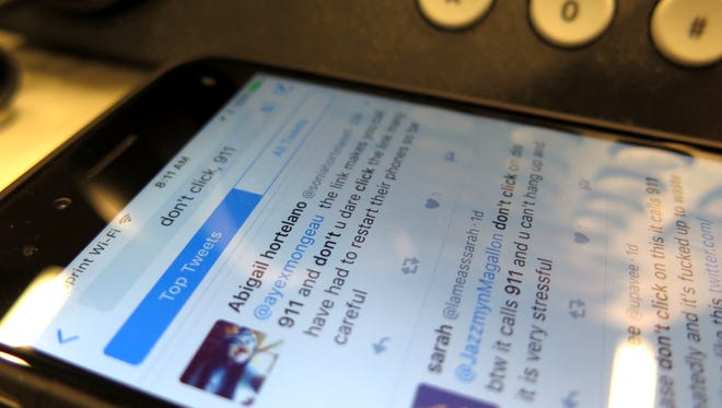 Several Twitter users have posted warning of a bad link that caused cellphones to repeatedly dial 911.