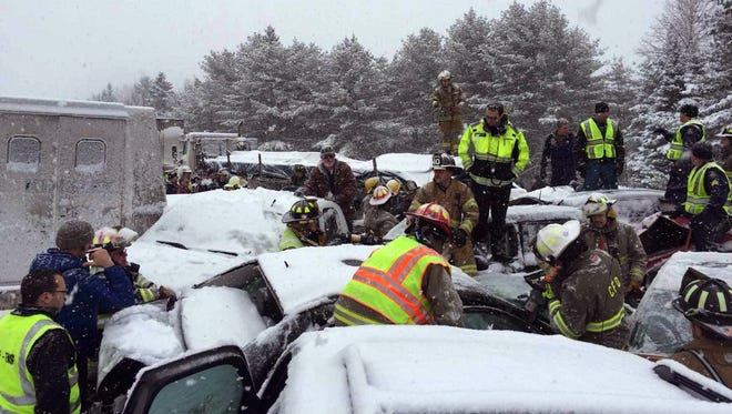 In this photo provided by Maine State Police And Maine Emergency Management, emergency personnel respond to a multi-vehicle pileup on Interstate 95 near Bangor, Maine, Wednesday, Feb. 25, 2015.