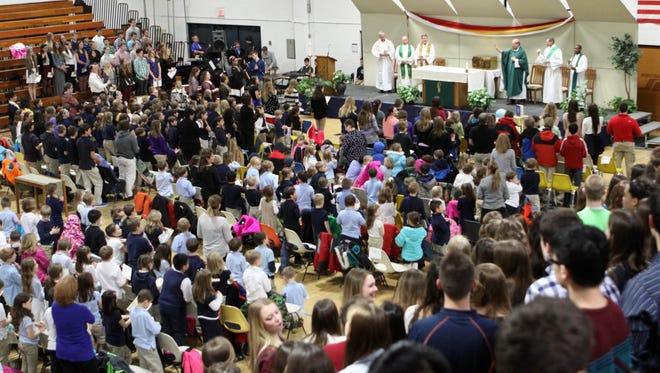 Catholic Schools Week mass in gym at Roncalli.