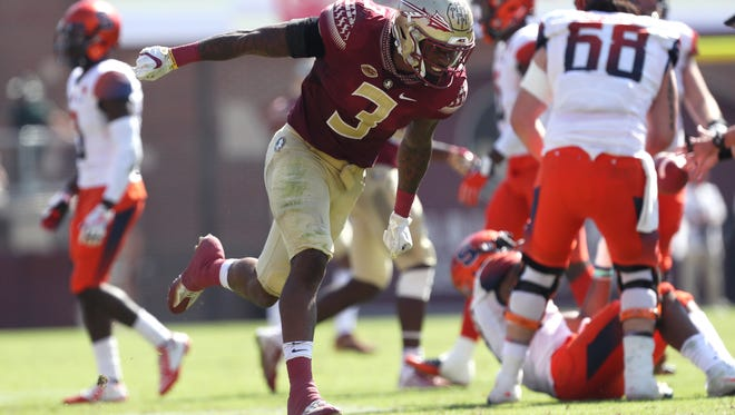FSU's Derwin James celebrates breaking up a pass against Syracuse during their game at Doak Campbell Stadium on Saturday, Nov. 4, 2017.