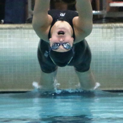 Germantown's Stephanie Marks comes off the blocks at last year's WIAA state swim meet. She is one of the leading returnees for the Warhawks this fall.