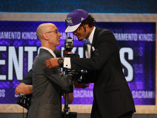 Willie Cauley-Stein (Kentucky) greets NBA commissioner