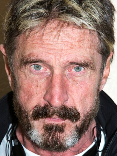 John McAfee in his hotel room in Mount Juliet, Tenn. McAfee has a new business that he has launched while on the run from a Belizean hit squad.