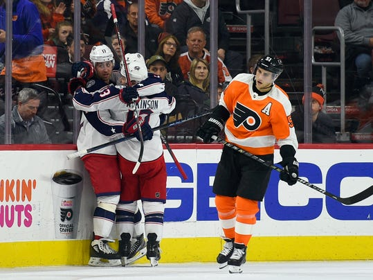 From left, Columbus Blue Jackets' Brandon Dubinsky, Artemi Panarin and Cam Atkinson (13) celebrate as Philadelphia Flyers' Valtteri Filppula skates past after Panarin scored a goal during the second period of an NHL hockey game, Thursday, Feb. 22, 2018, in Philadelphia. (AP Photo/Derik Hamilton)