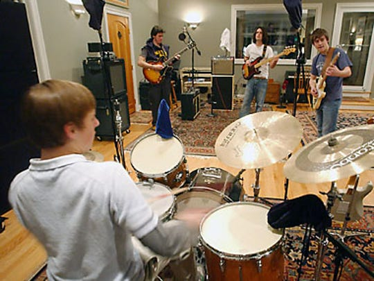 """Johnny Duke & the Aces, which includes (from left) Cam Tyler, Johnny """"Duke"""" Lippincott, Ian Walsh and Parrish Warrington, rehearse in Hockessin in 2006."""