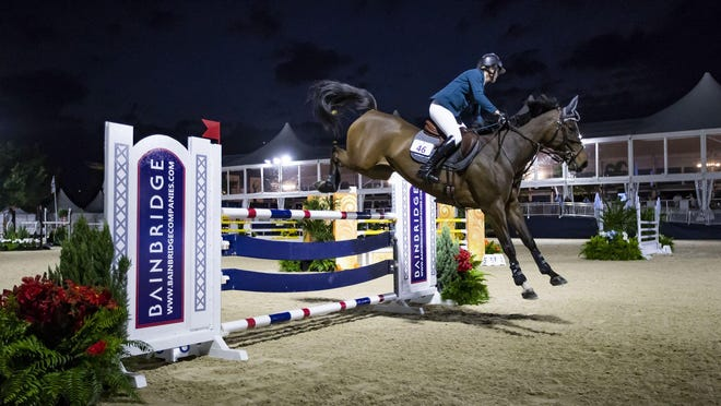 Ireland's Julian Cournane riding Sunny van de Hunters clears a jump at the 2020 Palm Beach Masters in Wellington, Jan 29. Cournane placed 11th in the first-ever class held under the lights at Deeridge Farms. The event was part of the brand new Sunset Challenge, which features competition in the evening hours. Events and parking are free and open to the public.