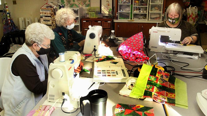 Margie Rigney, left, Nancy Gray and Pam Ferguson sew during a work session of Wanda's Circle on Monday, Nov. 2, 2020, at Cedarville United Methodist Church in Cedarville.