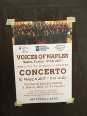 A poster advertises the coming concert by Voices of Naples in Venice.