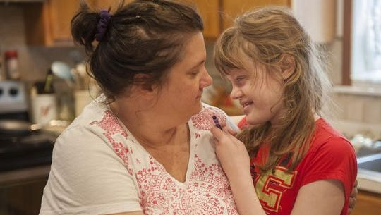Lora Barbour, shown here with daughter Genny several years ago, was fighting for her daughter to receive medical marijuana at her school.