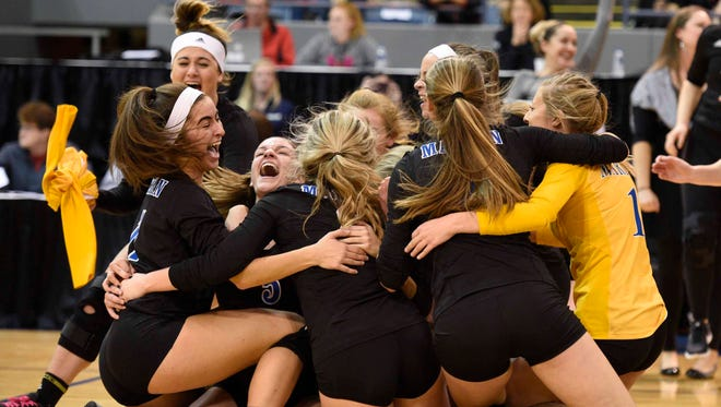 Marian players are ecstatic after defeating rival Mercy in the Class A semifinals in Battle Creek.