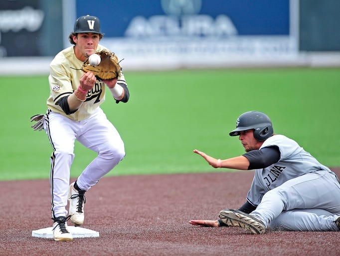 Vanderbilt second baseman Dansby Swanson, left, forces out South Carolina's Kyle Martin during the second inning at Vanderbilt University's Hawkins Field in Nashville, Tenn., Saturday, May 17, 2014. South Carolina won 6-3.