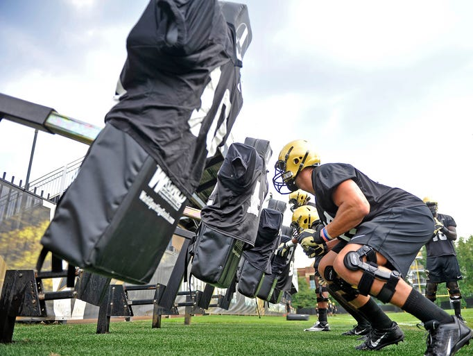 Vanderbilt players including Casey Hughes practice during the first day of the training camp in Nashville, Tenn., Thursday, July 31, 2014.