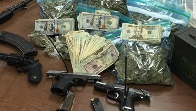 Nearly 12 pounds of marijuana, some heroin and six guns were seized, Indianapolis police said, in a raid at a home in the 6100 block of Commodore Drive on the city's east side Thursday, Sept. 1, 2016.