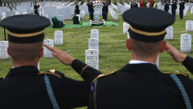 Above, ARLINGTON, VA - AUGUST 14: Members of the U.S. Army salute as the casket of U.S. Army Maj. Gen. Harold J. Greene is carried to the gravesite during a full honors funeral service at Arlington National Cemetery, August 14, 2014 in Washington, DC. Greene was shot and killed as he visited Afghanistan's national military academy in Kabul, Afghanistan. He is the highest ranking Army officer killed in combat since the Vietnam War. (Photo by Mark Wilson/Getty Images)