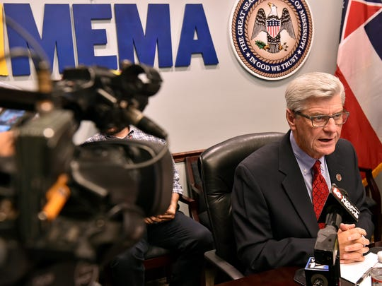 Governor Phil Bryant speaks to the press following
