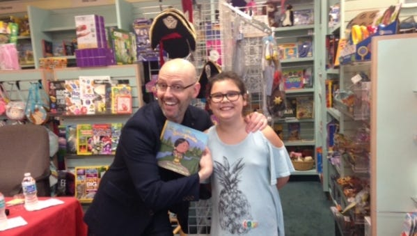 """Author Brad Meltzer recently attended a book signing at the Vero Beach Book Center to promote two of his new books for children, """"I am Gandhi"""" and """"I am Sacajawea."""" He will speak Nov. 11 at the annual meeting of the Friends of St. Lucie County  Library Association."""