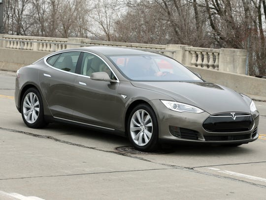 Tesla Model S 70-D electric car is test driven in Detroit in April 2015.