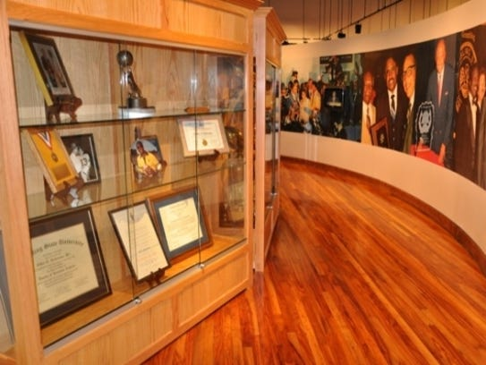 Trophy cases and a wall of photos line the Eddie G.