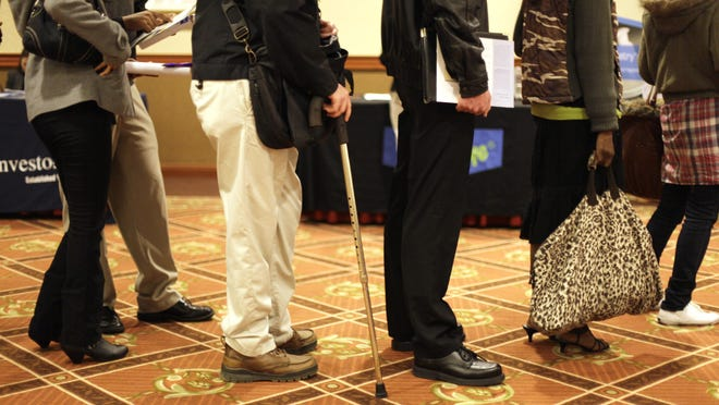 File photo of job seekers at a career fair.