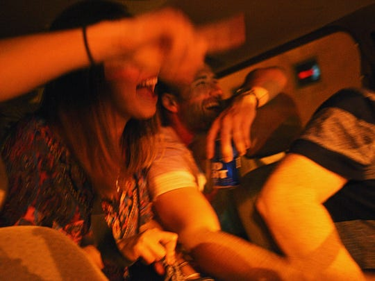 """Kimberly Cuadros and Wyman Wenz get a ride downtown from John Hodgson, of Metro Cab, Friday, May 12, 2017, in Sioux Falls. """"You don't know what's coming next,"""" Hodgson said about driving a cab. """"That's the fun part,"""" he said. Hodgson is active on Snapchat, and communicates with about 50 percent of his clients on Friday and Saturday nights using the application, he said. Hodgson also has a liquor license and serves his clients alcohol."""