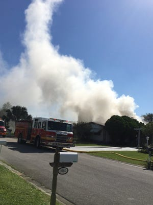 A single-wide mobile home caught fire Saturday morning in Barefoot Bay, Brevard County Fire Rescue officials reported.