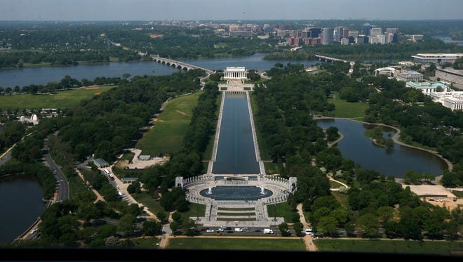 """The Lincoln Memorial, rear, and the National World War II Memorial are seen from the 500-foot level of the Washington Monument in Washington. On Saturday, thousands of Christians will gather near those monuments on the National Mall for """"Together 2016."""""""