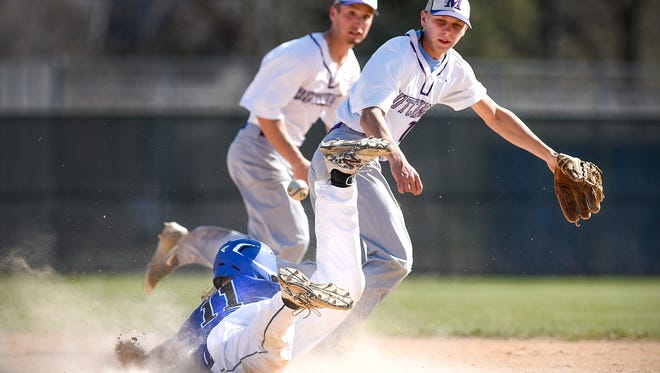 Foley's Noah Winkelman, 11, dives safely into second before Melrose's Tyler Moscho, right, could get the ball during the Third inning Friday, April 5, in Foley.