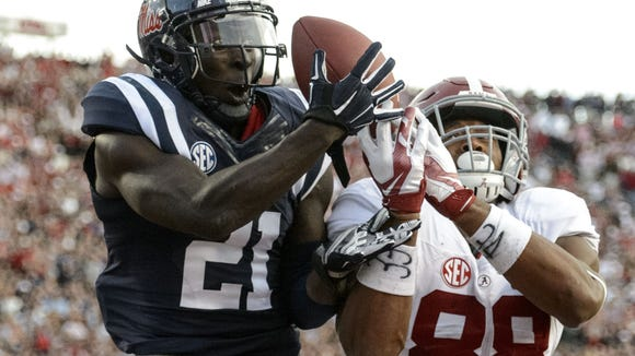VASHA HUNT/AL.COM/AP Ole Miss defensive back Senquez Golson intercepts a pass in the end zone intended for Alabama tight end O.J. Howard. Mississippi defensive back Senquez Golson (21) intercepts a pass in the end zone intended for Alabama tight end O.J. Howard (88) during the fourth quarter of an NCAA college football game in Oxford, Miss., Saturday, Oct. 4, 2014. No. 11 Mississippi beat No. 3 Alabama 23-17. (AP Photo/AL.com, Vasha Hunt)