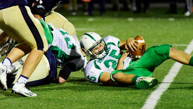 Margaretta's Collin Lane recovers a fumble Saturday forced by Simon Kromer.