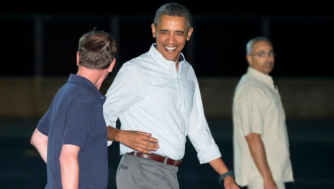 President Obama walks to board Air Force One at Honolulu Joint Base Pearl Harbor-Hickam.