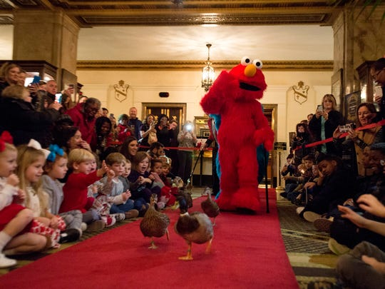 Honorary duckmasters Elmo and Cookie Monster walk the red carpet in the daily march of the ducks at Peabody Hotel on Friday, Dec. 9, 2016. The characters are in Memphis for performances in the Sesame Street Live production Elmo Makes Music, which plays this weekend at the Cannon Center for the Performing Arts.
