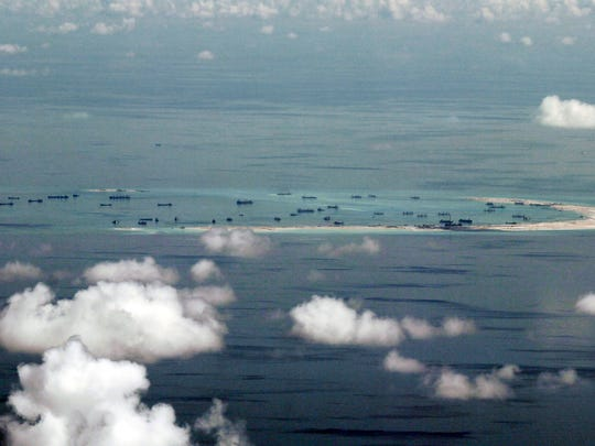 This May 11, 2015, file photo, shows land reclamation of Mischief Reef in the Spratly Islands in the South China Sea. (Ritchie B. Tongo/Pool Photo via AP, File)