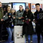 Hockey fans bring gloves, hats for needy; Plymouth brings heat in 9-1 win