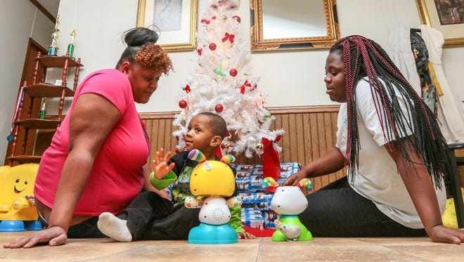 Carolyn Gray, left, daughter Averiona, right, and son Sevyn at their home in Anderson.