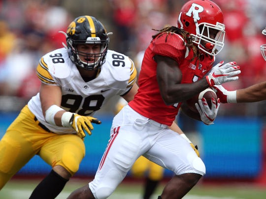 Iowa defensive end Anthony Nelson chases down Rutgers receiver Janarion Grant in the Hawkeyes' 14-7 win last Saturday.