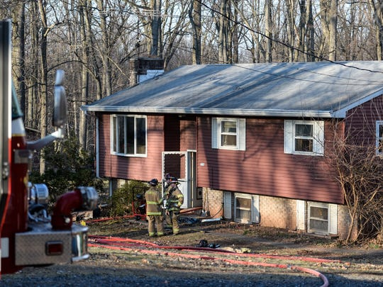 Fire crews clean up after a minor electrical fire left one woman homeless at 218 Schoolhouse Road in South Londonderry Township on Wednesday, March 9 2015.