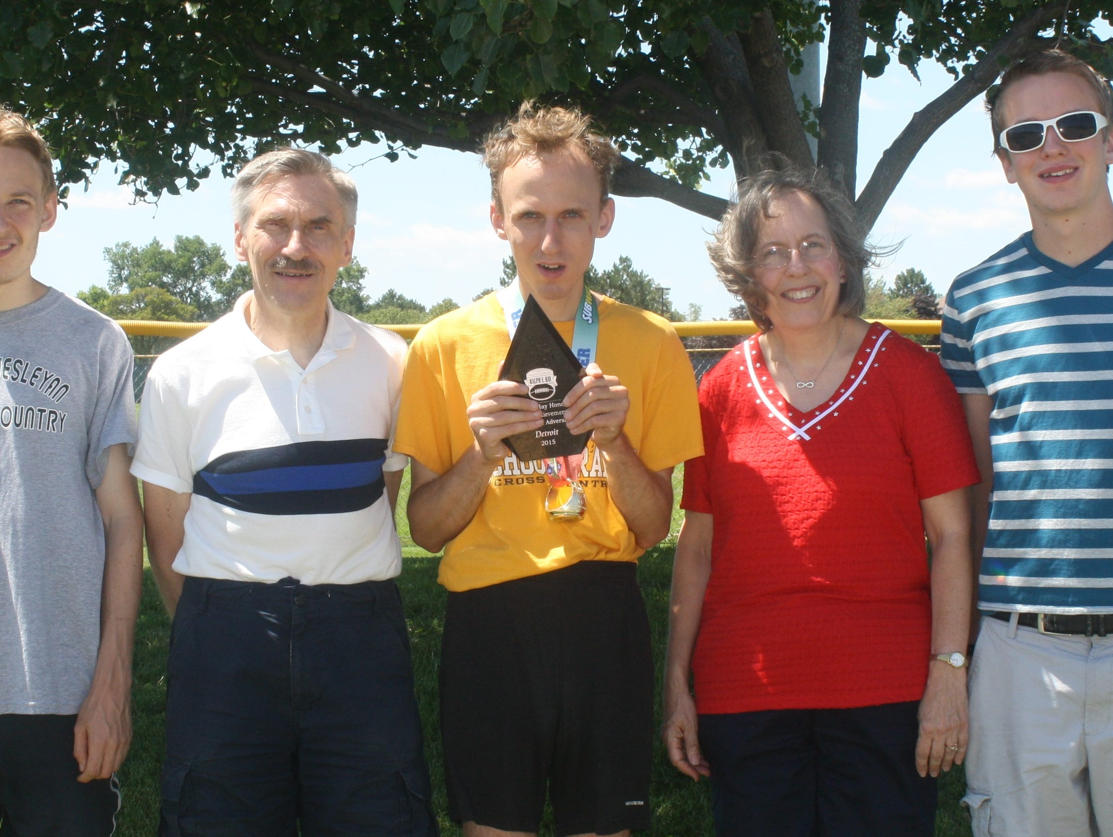 Scott Howse (middle) is pictured with his parents, Ken and Connie, and brothers Shawn and Franklin.