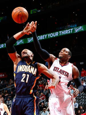 ATLANTA, GA - JANUARY 21:  David West #21 of the Indiana Pacers and Paul Millsap #4 of the Atlanta Hawks battle for a rebound at Philips Arena on January 21, 2015 in Atlanta, Georgia.  NOTE TO USER: User expressly acknowledges and agrees that, by downloading and or using this photograph, User is consenting to the terms and conditions of the Getty Images License Agreement.  (Photo by Kevin C. Cox/Getty Images)