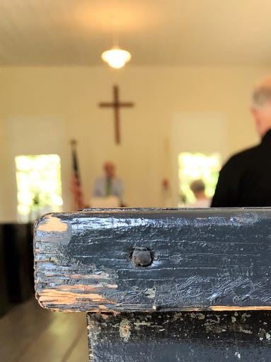 Old hand-hewn pews and hand-made nails are part of