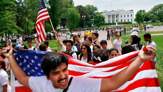 Manuel Vazquez, 20, of Raleigh, N.C., front, attends a May Day immigration reform rally by the White House in Washington, on May 1, 2010.