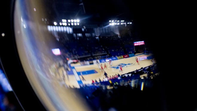 The arena is reflected within a spotlight lens at the TSSAA boys state basketball championships at the Murphy Center in Murfreesboro, Tennessee on Thursday, March 15, 2018.