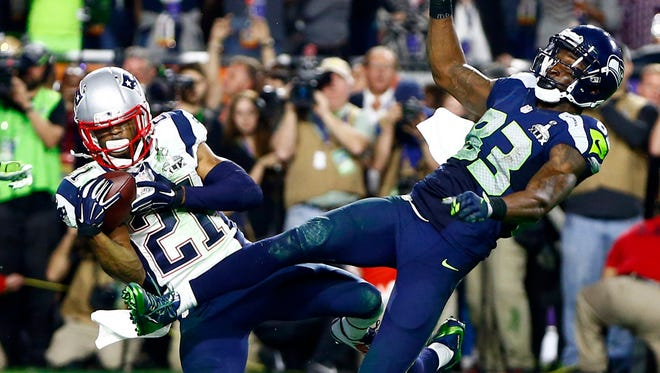 Malcolm Butler intercepts a pass intended for Seattle Seahawks wide receiver Ricardo Lockette to clinch a Super Bowl victory for the Patriots in Glendale, Ariz.