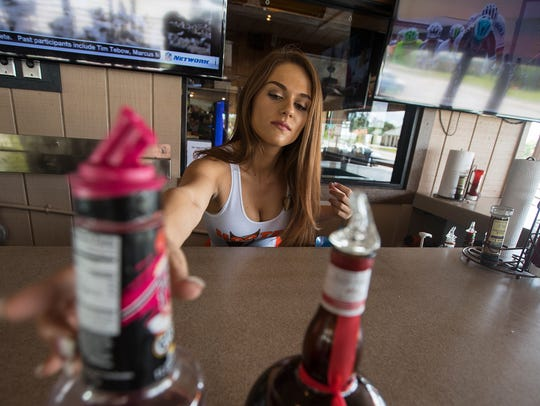 Mariah Materiale, 22, of Cape Coral,  prepares her