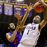 LSU forward Jarell Martin (1) grabs a rebound over Florida forward Jon Horford (21) on Feb. 21 at the Pete Maravich Assembly Center.