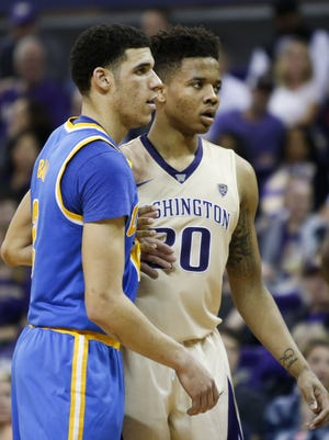 Lonzo Ball and Markelle Fultz guard each other during a game at Alaska Airlines Arena.