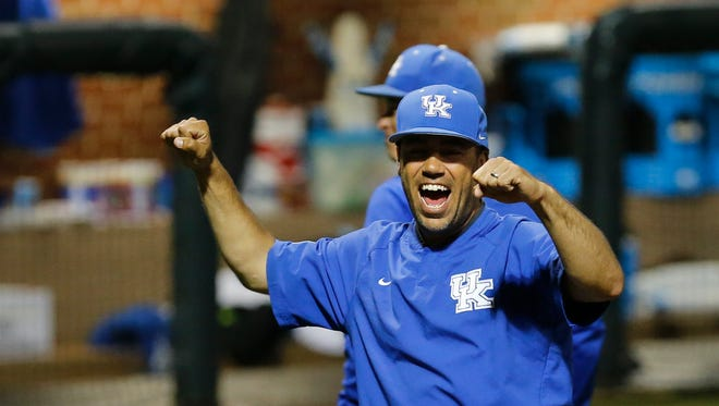 Kentucky's Coach Nick Mingione celebrates after the Cats advance to the Super Regional. 
